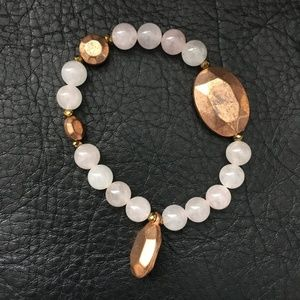 Rose quartz beaded bracelet with vintage charms